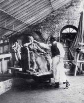 Paolo Troubetzkoy works on a statue of Duchess Tenisheva at her Talashkino estate near Smolensk. 1899