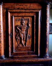 A small cupboard with a carved door. 16th century (?)