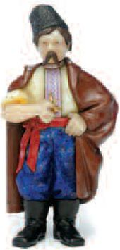 Lot 45. An Important Fabergé Carved Flardsfone Figure of a Ukranian Peasant, St. Petersburg, c. 1909