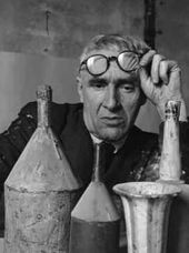 Portrait of Giorgio Morandi in his studio. 1953
