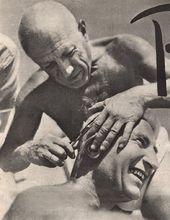 Pablo Picasso gives Iliazd a haircut. Côte d'Azur. 1947