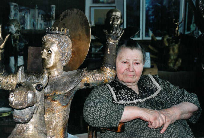 "Adelaida Pologova in her studio with the composition ""St. George"" (2004, bronze)"