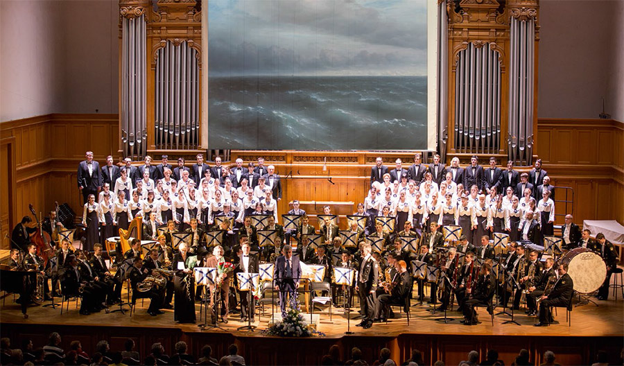 The Rimsky-Korsakov Central Exemplary Navy Concert Band of Russia and the Academic Choir of the Lomonosov Moscow State University on the stage of the Great Hall of Moscow Conservatory