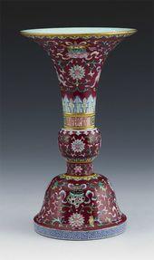 Ruby-ground Famille-rose Altar Vase. Jingdezhen ware. Porcelain Emperor Qianlong, Qing Dynasty (1736-1796)