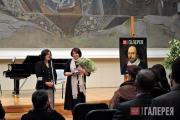 Zelfira Tregulova awarding a commemorative medal to Tatyana Karpova