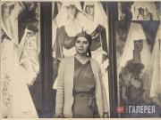 "Natalia Goncharova at her studio with the polyptych ""Spanish Women"""