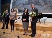 Zelfira Tregulova awarding a commemorative medal to Michael Bird