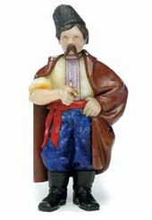 Lot 45. An Important Faberge Carved Hardstone Figure of a Ukranian Peasant, St. Petersburg, c. 1909