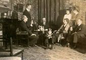 Alexander Ilyich Ziloti (left) and Vera Pavlovna Ziloti (in the armchair) among their friends. Finland, 1919