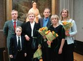 Sergei and Nikita Fadeyev, Yekaterina S. Khokhlova, Alex, Mary and Grace Ziloti in front of the portrait of Vera Nikolayevna Tretyakova. Moscow, May 2006