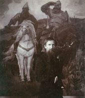 "Viktor Vasnetsov with ""Warrior Knights"" in the background. Photograph, 1898"
