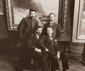"From left: sitting, Arkady Chumakov, Konstantin Bogaevsky; standing, Yevgeny Stolitsa, Arkady Rylov in Kuindzhi's studio at the Imperial Academy of Fine Arts, in front of Chumakov's painting ""A Quiet Day"" (1897). Late 1890s"