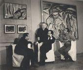 "Sitting, from left: Tair Salakhov, Nadir Abdurakhmanov, Togrul Narimanbekov; standing: Pyotr Yelistratov. Nikonov's painting ""Geologists"" is hanging on the wall of Yelistratov's official dacha. Baku. 1965"