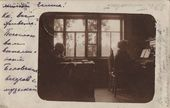 Vasily Polenov in his study listening to music. Vera Wolf at the piano. Photograph. 1910s