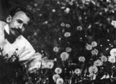 Viktor Borisov-Musatov among dandelions. Photograph. Early 1900s