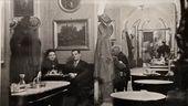 19th-century photograph of the interior at the Caffè Greco, with Elsa Morante and Alberto Moravia
