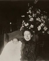 Maria Yakunchikova-Weber with her son Stepan by a Christmas tree