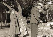 "Robert Falk preparing to paint en plein air. On the left, N.T. Prozorova with his painting ""Khotkov Monastery"". 1954"